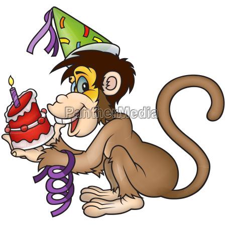 monkey holding birthday cake