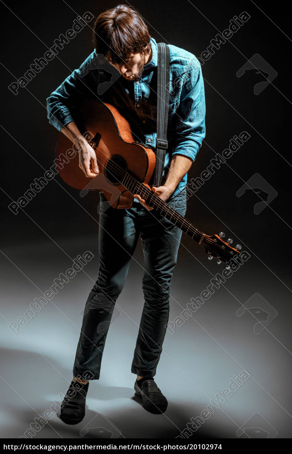 cool, guy, standing, with, guitar, on - 20102974