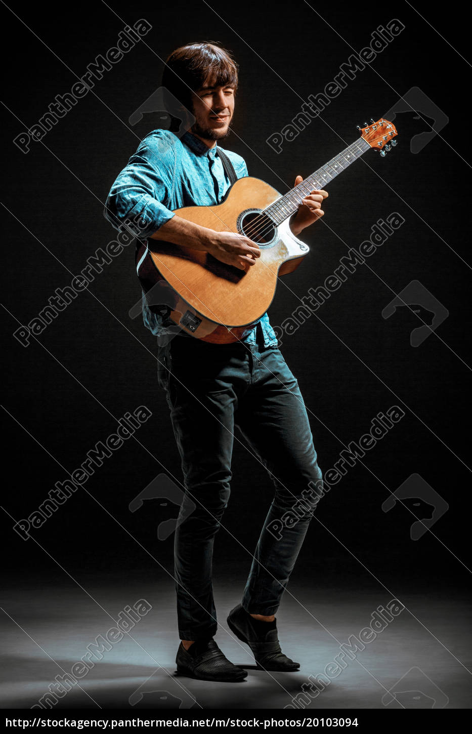 cool, guy, standing, with, guitar, on - 20103094