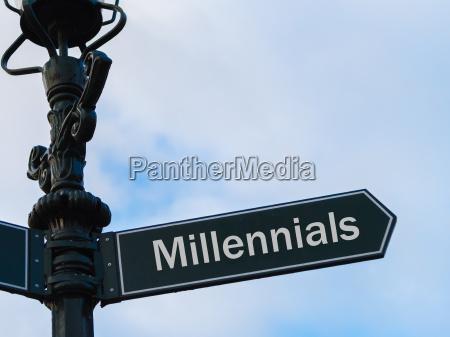 millennials directional sign on guidepost