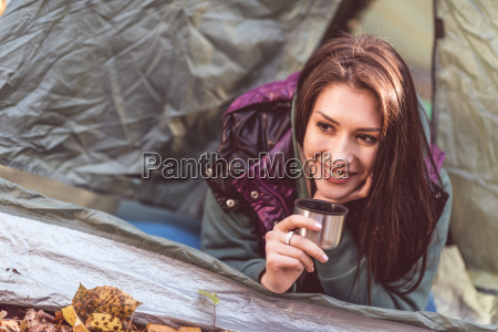 woman, in, tent, holding, metallic, cup - 20115028