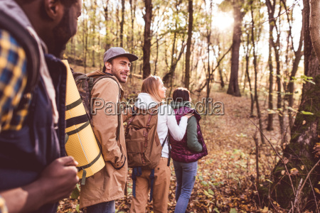 young, backpackers, in, autumn, forest - 20115034