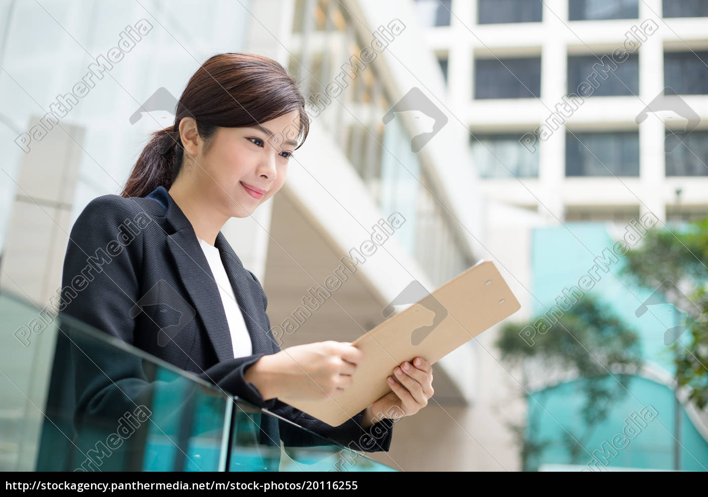 asian, business, woman, reading, on, clipboard - 20116255