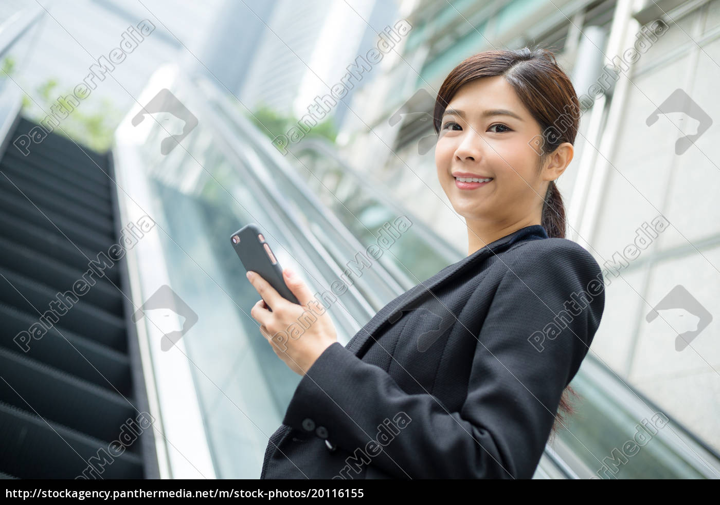 business, woamn, holding, cellphone, and, standing - 20116155