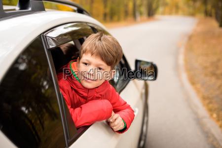 smiling, boy, looking, through, car, window - 20116297