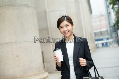 young, businesswoman, holding, a, coffee, cup - 20116335