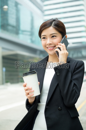 young, businesswoman, talk, to, phone, and - 20116325