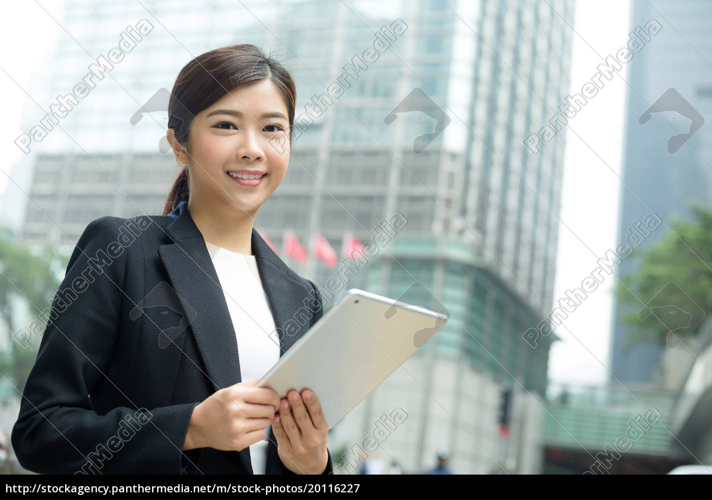 young, businesswoman, use, of, digital, tablet - 20116227