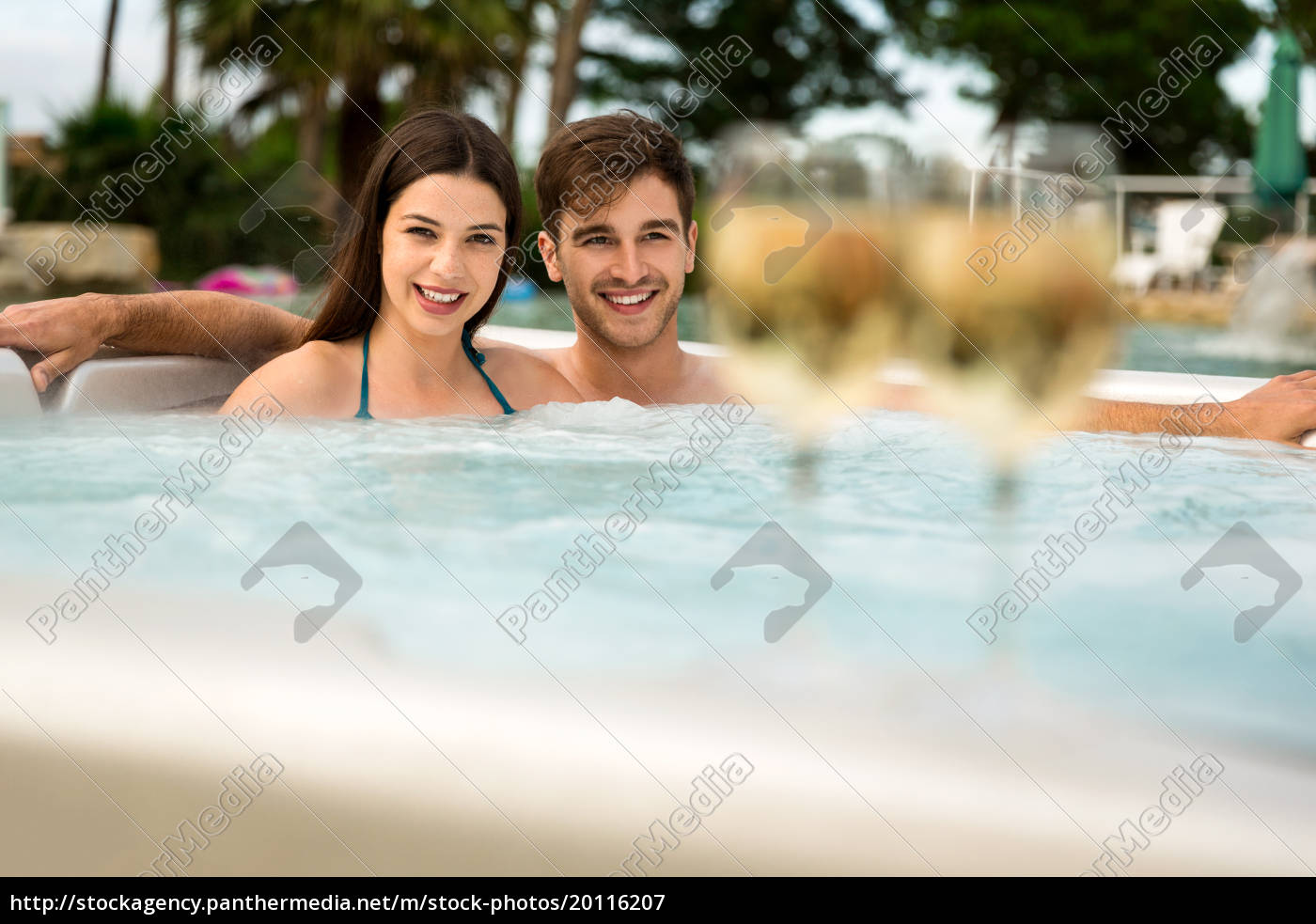 young, couple, in, a, jacuzzi - 20116207