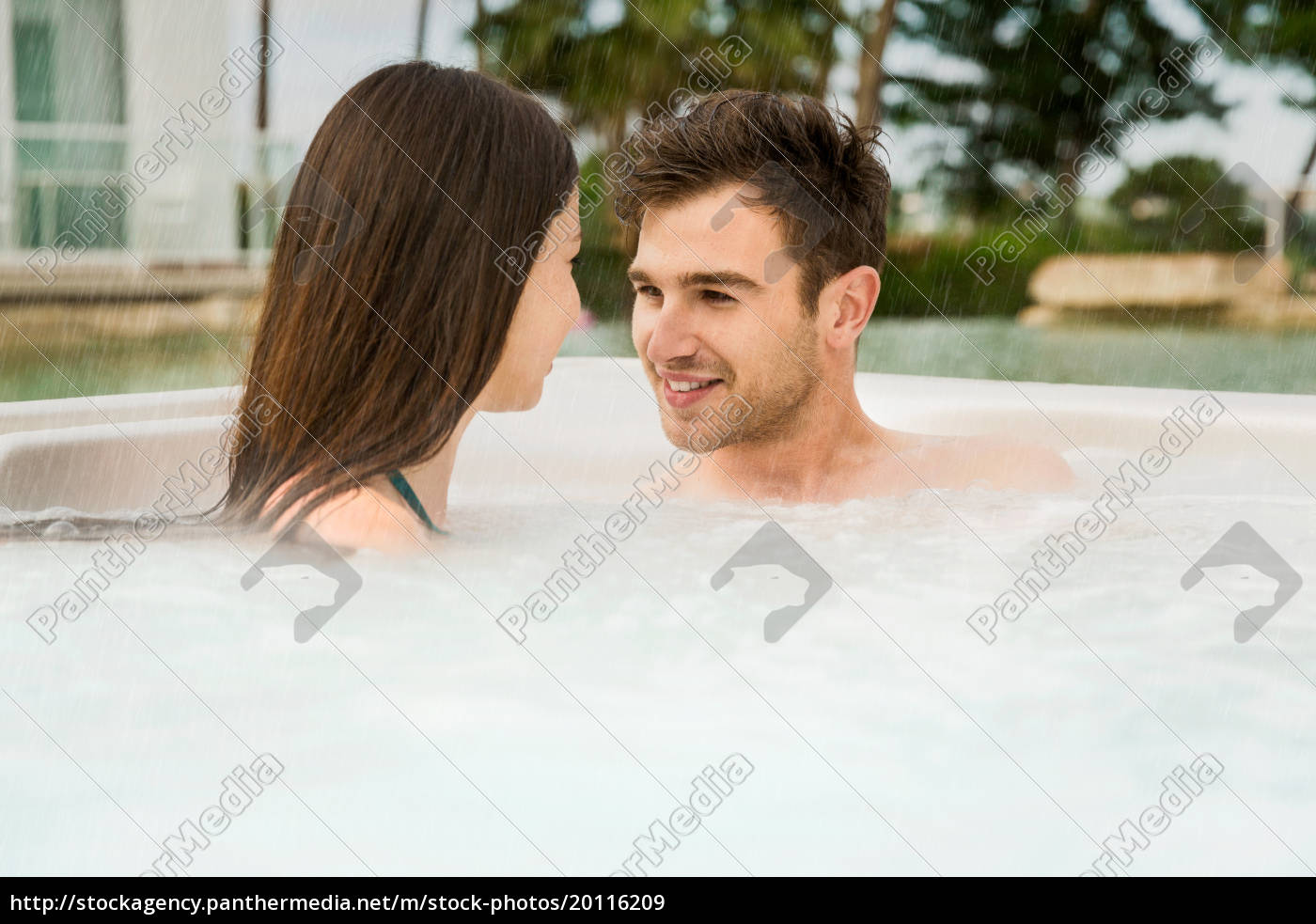 young, couple, in, a, jacuzzi - 20116209