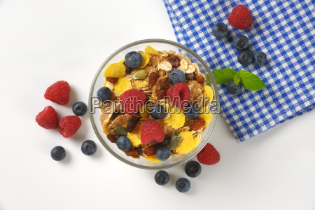 bowl of breakfast cereals and fresh