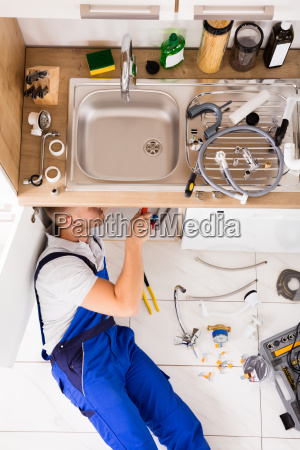 male, plumber, in, overall, fixing, sink - 20117767