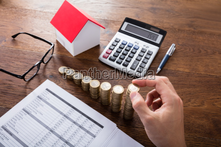 person, stacking, coins, on, wooden, desk - 20117993