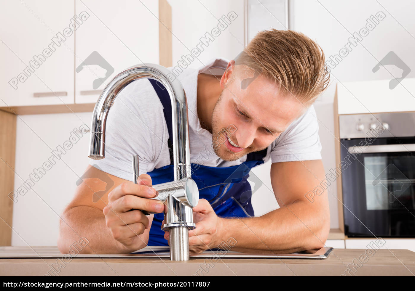 plumber, fixing, faucet, in, kitchen - 20117807