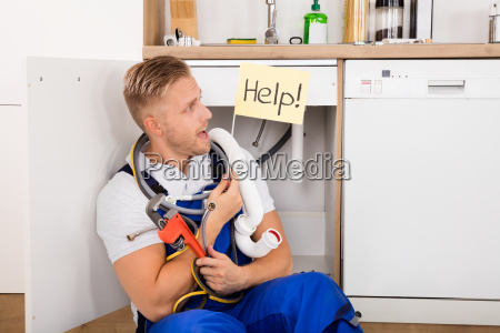 plumber, holding, flag, with, help, text - 20117769