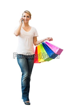 woman, using, mobile, phone, while, carrying - 20118839