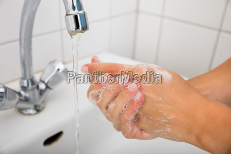 woman applying soap on the hand