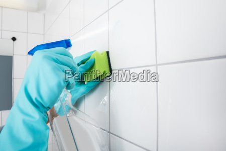 close-up, of, person, cleaning, the, tiled - 20119441