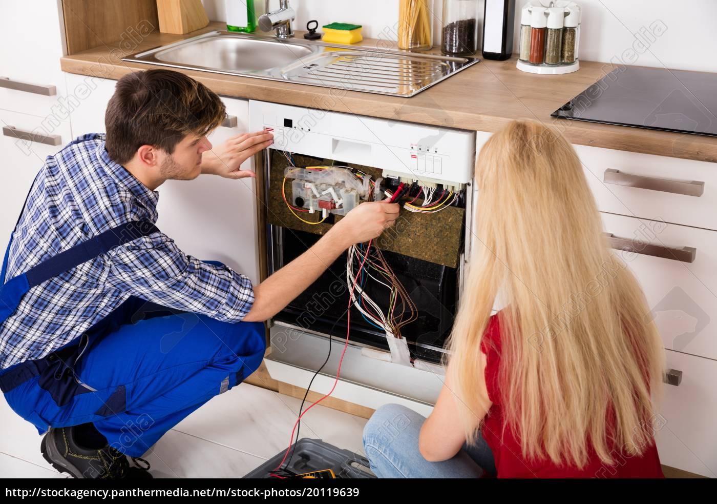 technician, checking, dishwasher, in, kitchen - 20119639