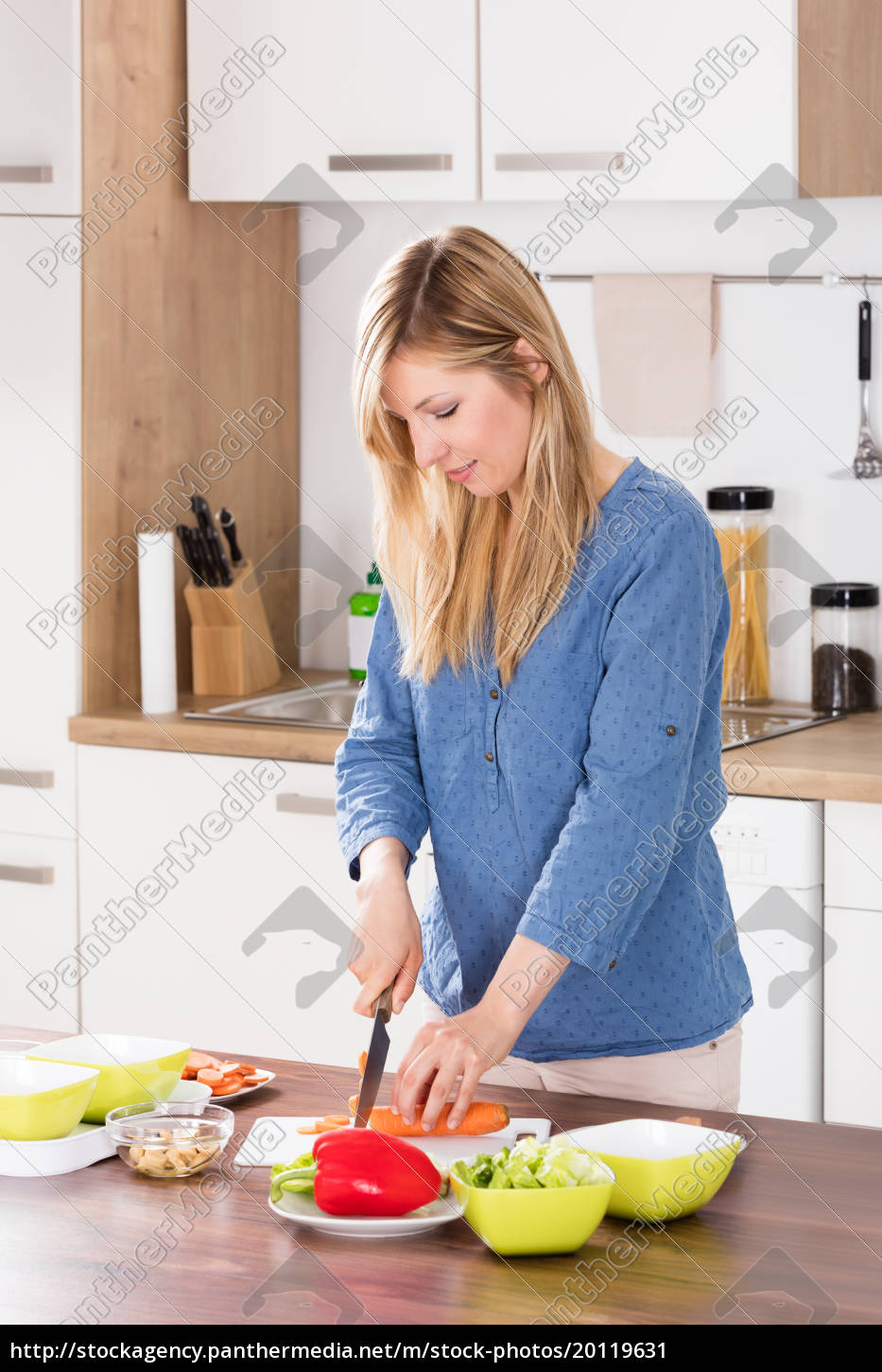woman, cutting, vegetable, on, chopping, board - 20119631