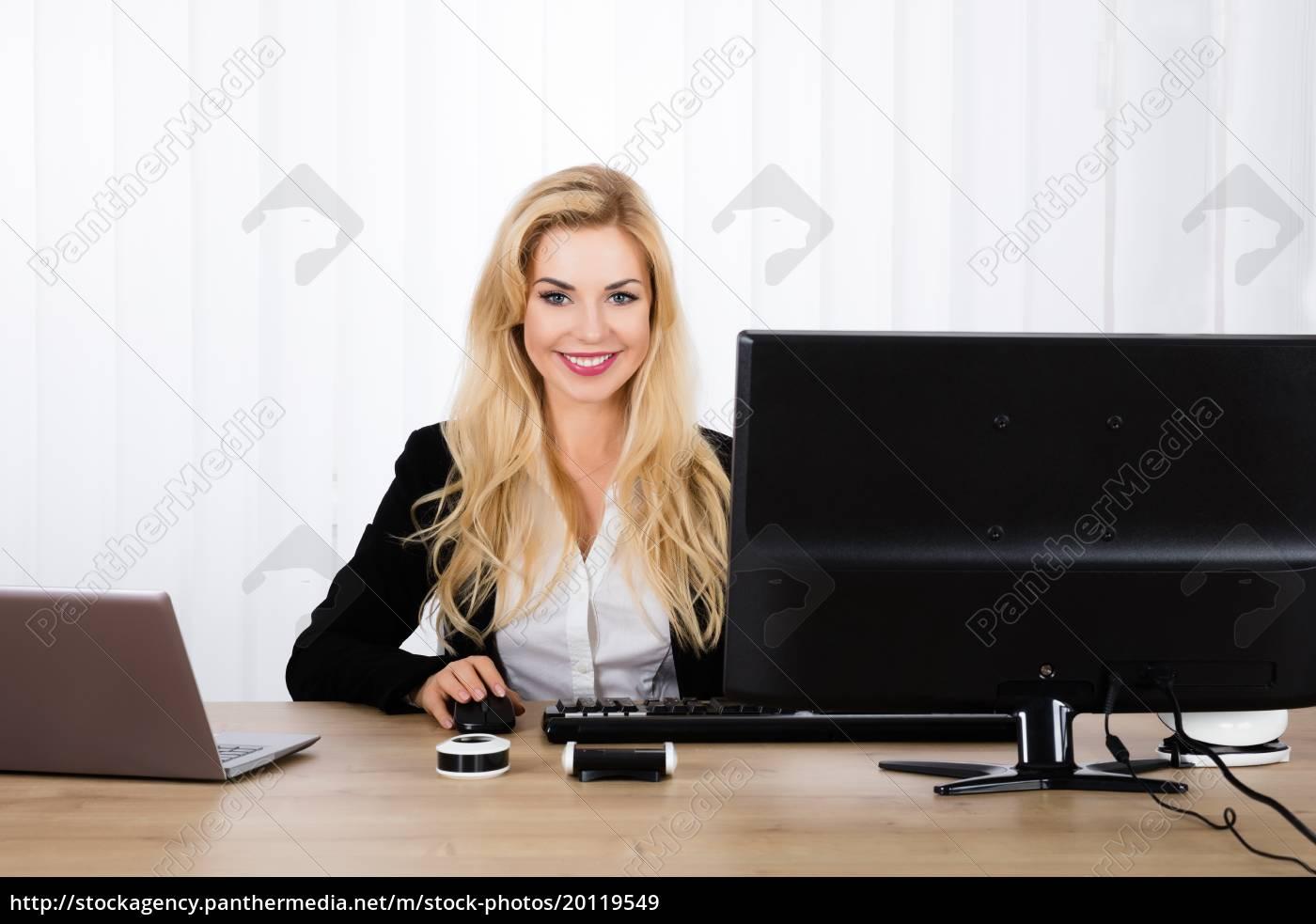woman, sitting, on, office, desk - 20119549