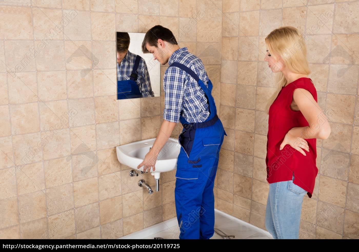 young, handyman, installing, sink, in, bathroom - 20119725