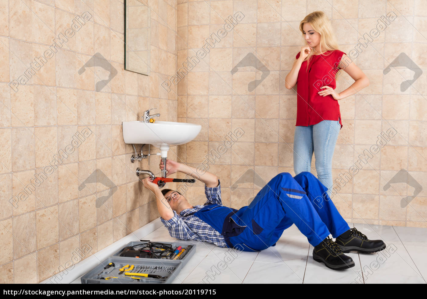 young, male, plumber, repairing, sink, in - 20119715