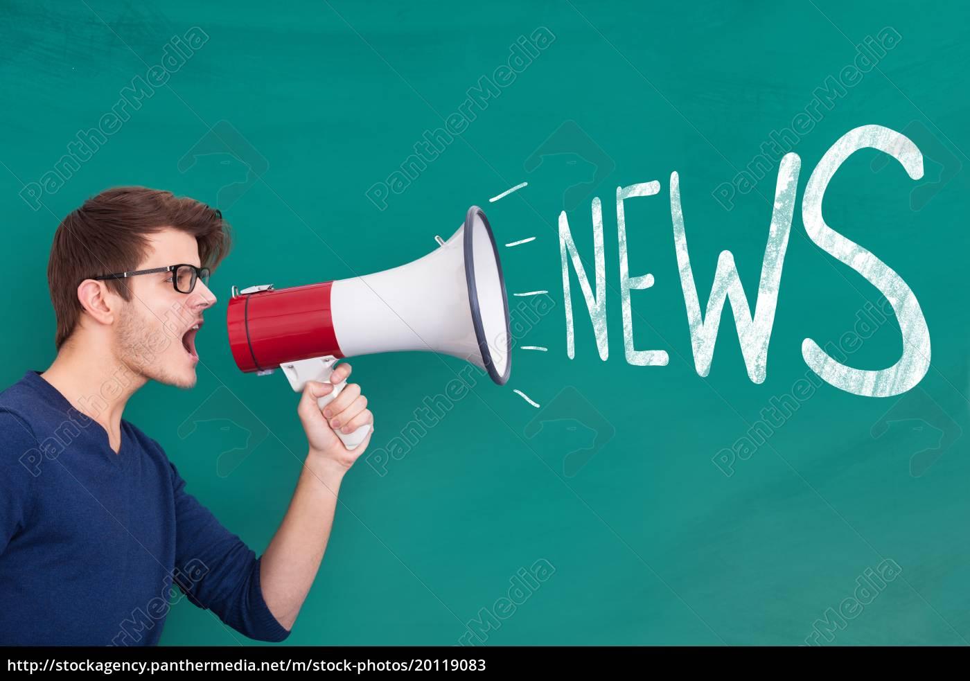young, man, shouting, in, megaphone - 20119083