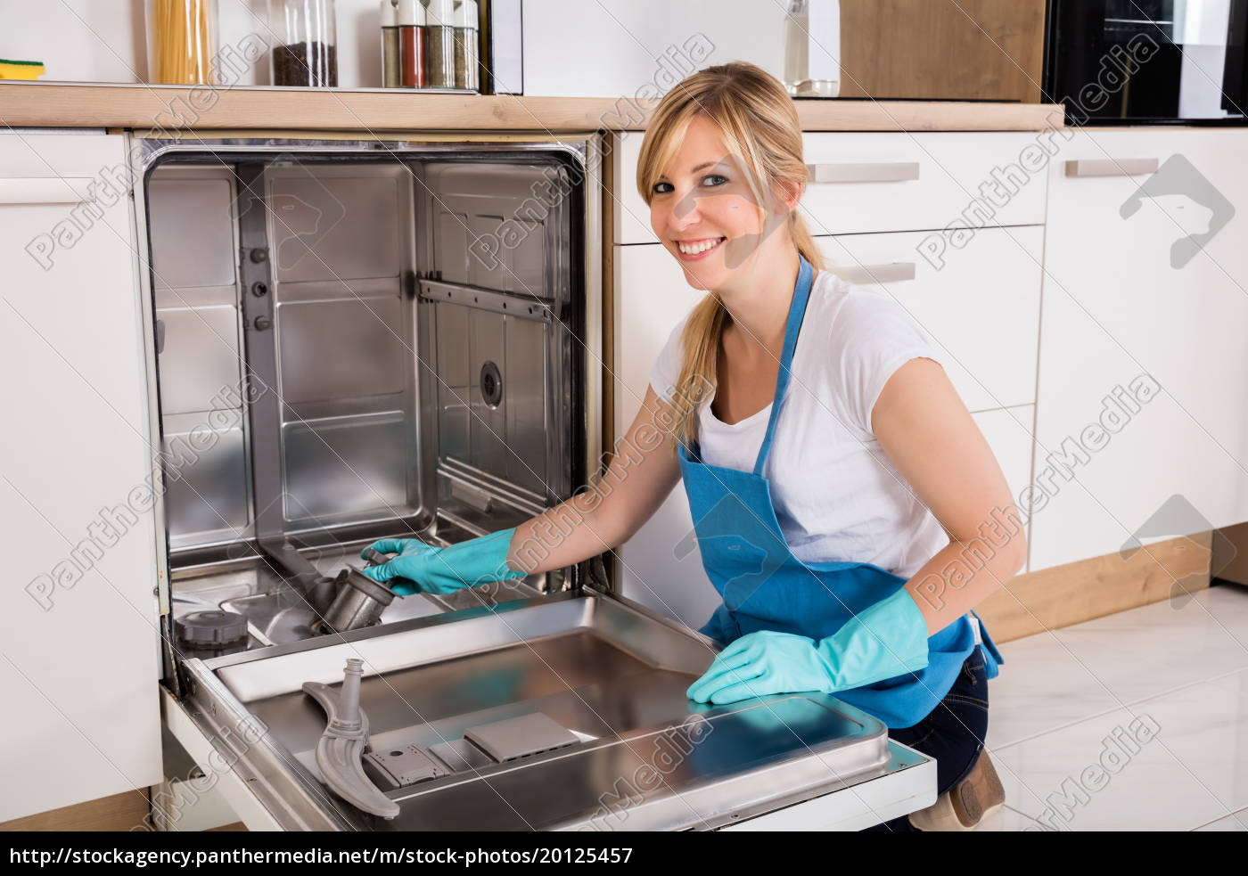 woman, cleaning, dishwasher, in, kitchen - 20125457