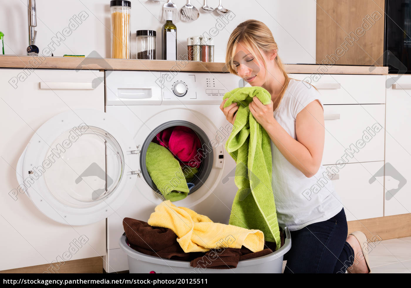 woman, smelling, cleaned, clothes, near, washing - 20125511