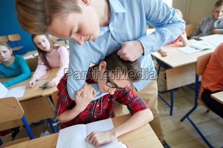 student boy suffering of classmate mockery