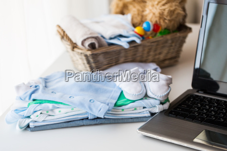 close up of baby clothes toys