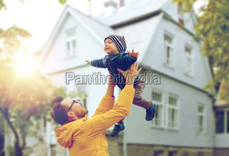 father with son playing and having