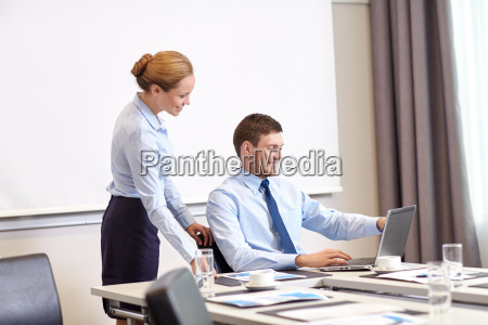 businessman and secretary with laptop in
