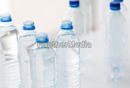 close up of bottles with drinking