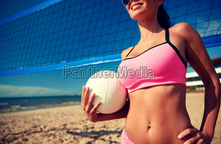 young woman with volleyball ball and