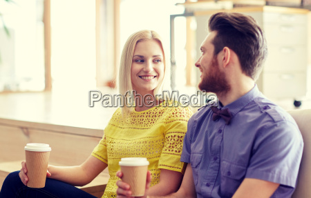 happy man and woman drinking coffee