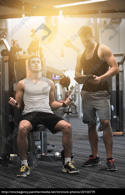 man, exercising, on, gym, machine - 20150779