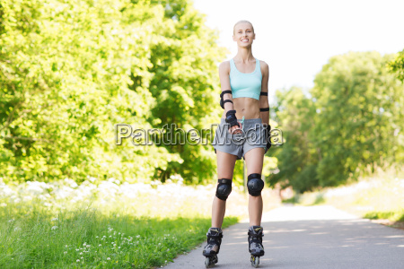 happy, young, woman, in, rollerblades, riding - 20151077