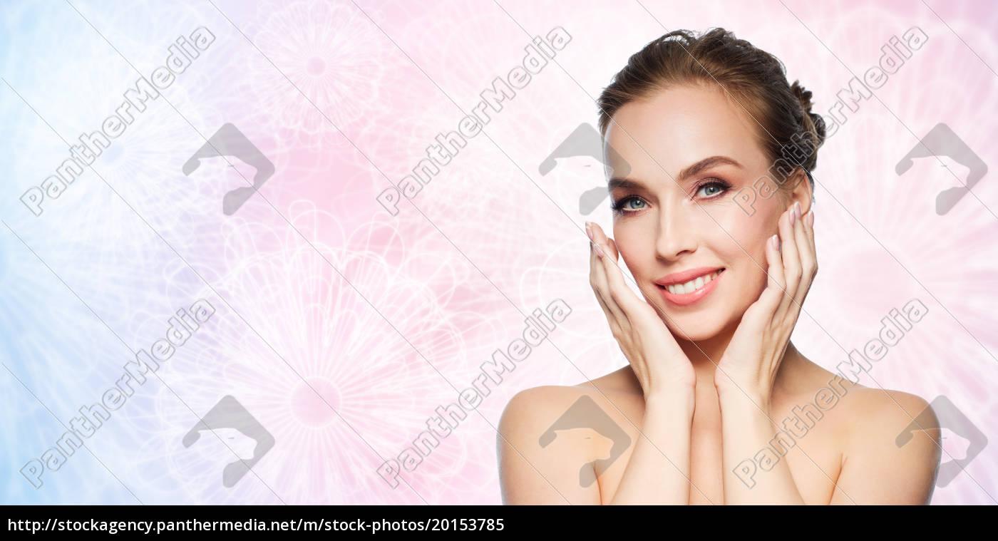 beautiful, young, woman, touching, her, face - 20153785
