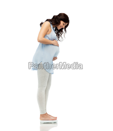happy, pregnant, woman, measuring, weight, on - 20153979