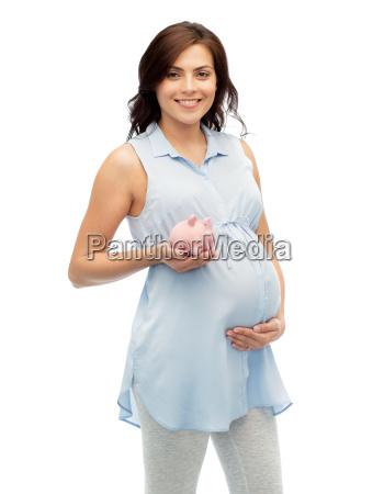 happy, pregnant, woman, with, piggybank - 20153983