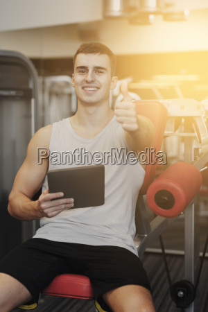 smiling, young, man, with, tablet, pc - 20153947