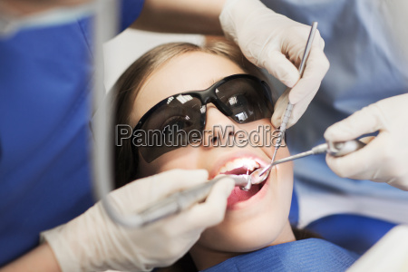 female, dentists, treating, patient, girl, teeth - 20154805