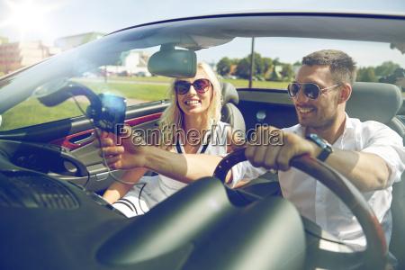 happy, couple, using, gps, navigator, in - 20154415