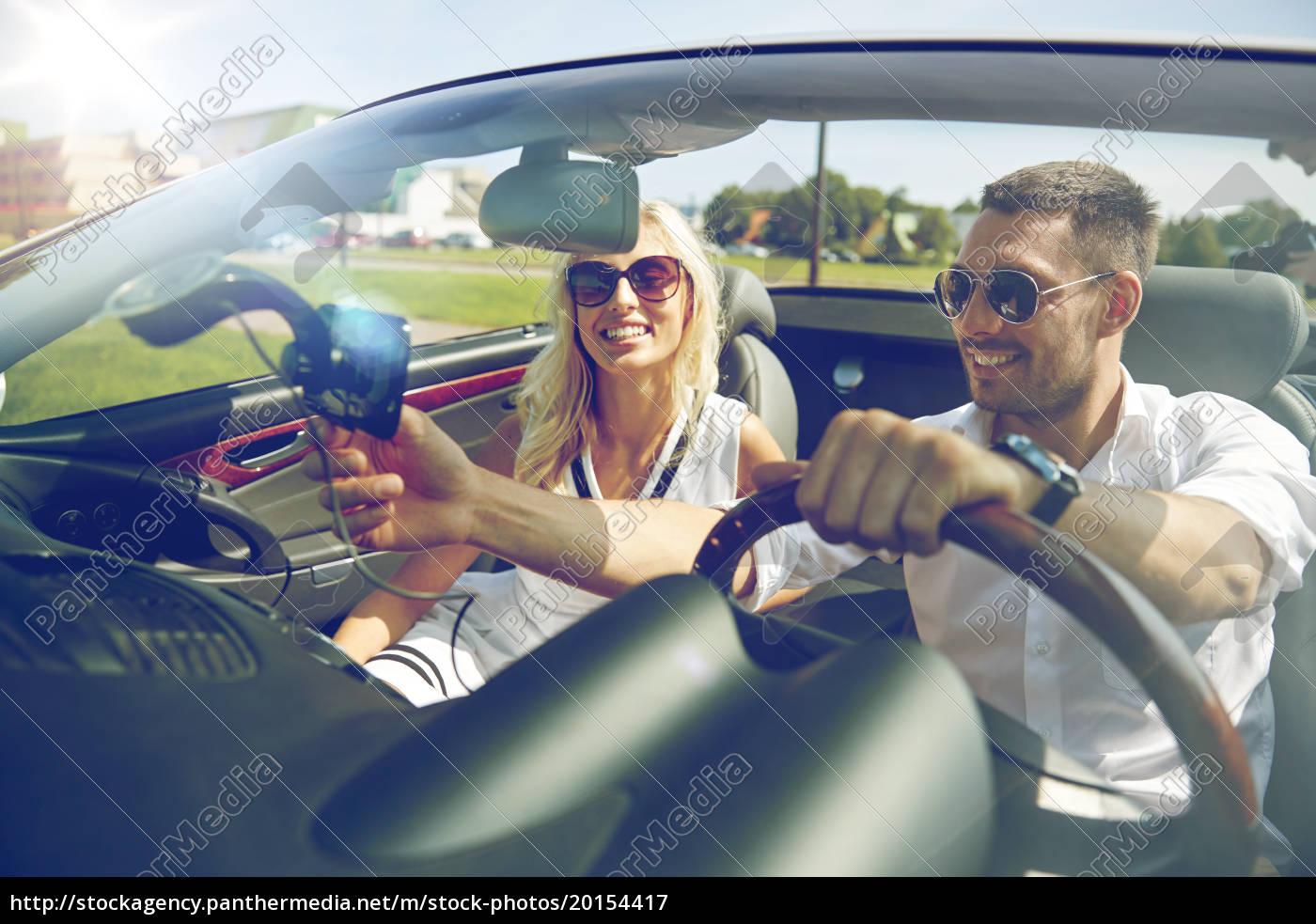 happy, couple, using, gps, navigator, in - 20154417