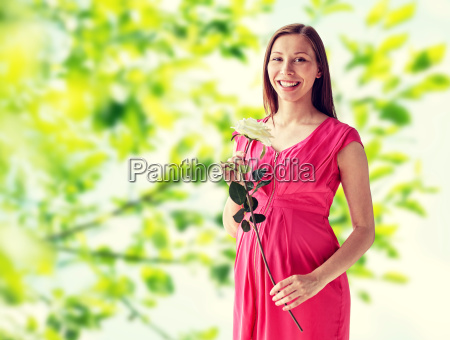 happy, pregnant, woman, with, rose, flower - 20154397