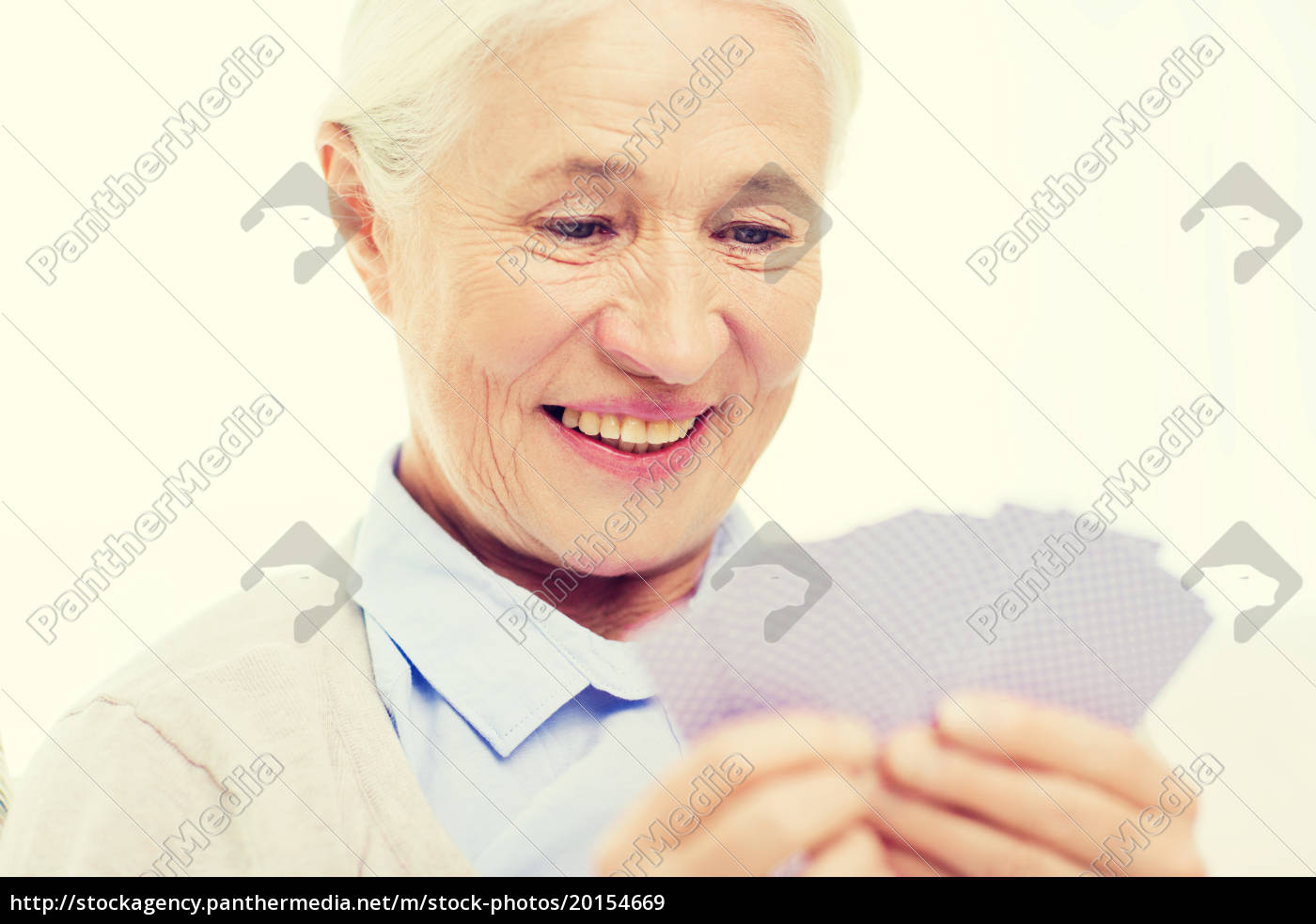 happy, senior, woman, playing, cards, at - 20154669
