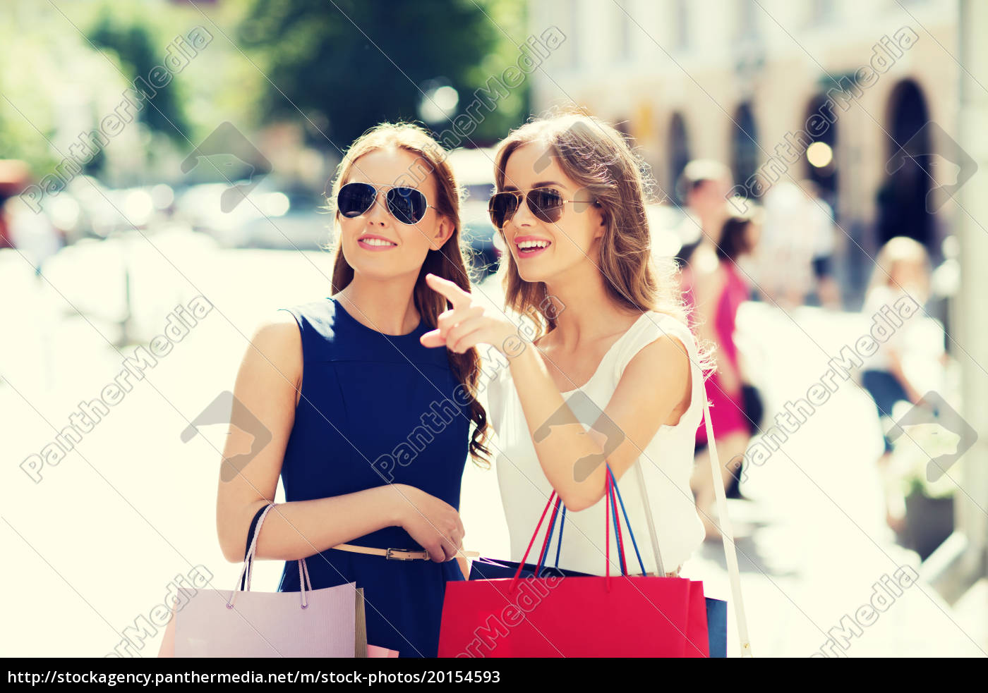 happy, women, with, shopping, bags, in - 20154593