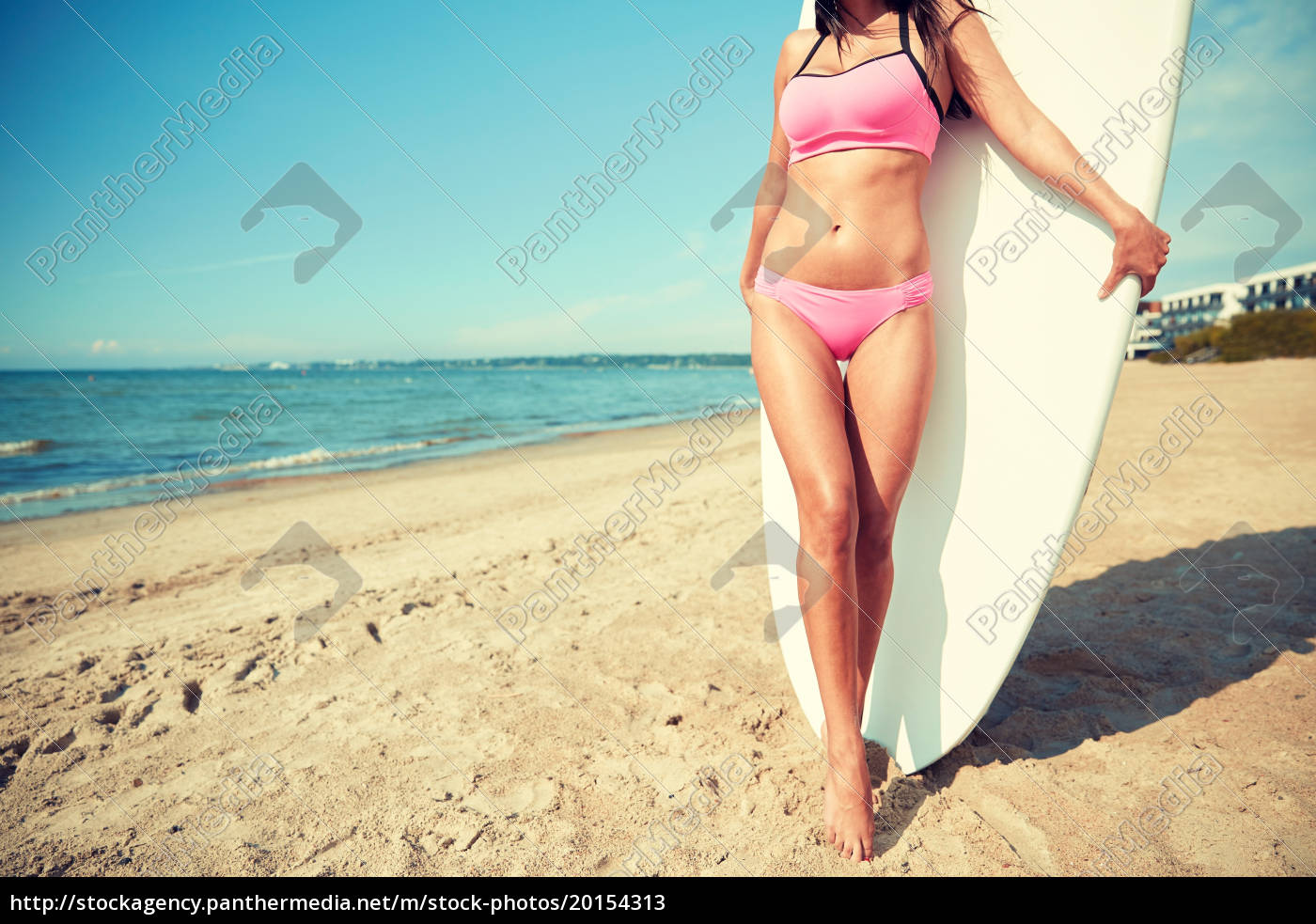 smiling, young, woman, with, surfboard, on - 20154313